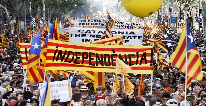 "People hold banner reading ""independence"" during a protest for greater autonomy for Catalonia within Spain in Barcelona"